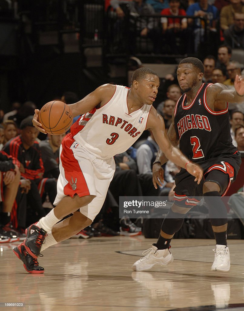 Kyle Lowry #3 of the Toronto Raptors drives against Nate Robinson #2 of the Chicago Bulls during the game between the Toronto Raptors and the Chicago Bulls on January 16, 2013 at the Air Canada Centre in Toronto, Ontario, Canada.