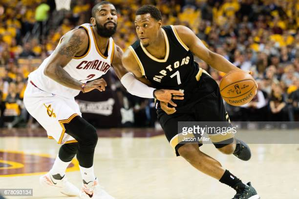 Kyle Lowry of the Toronto Raptors drives around Kyrie Irving of the Cleveland Cavaliers during the first half of Game Two of the NBA Eastern...