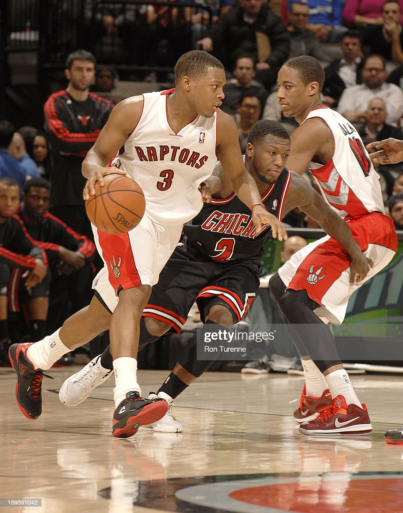 <a gi-track='captionPersonalityLinkClicked' href=/galleries/search?phrase=Kyle+Lowry&family=editorial&specificpeople=714625 ng-click='$event.stopPropagation()'>Kyle Lowry</a> #3 of the Toronto Raptors drives the ball against <a gi-track='captionPersonalityLinkClicked' href=/galleries/search?phrase=Nate+Robinson&family=editorial&specificpeople=208906 ng-click='$event.stopPropagation()'>Nate Robinson</a> #2 of the Chicago Bulls during the game between the Toronto Raptors and the Chicago Bulls on January 16, 2013 at the Air Canada Centre in Toronto, Ontario, Canada.