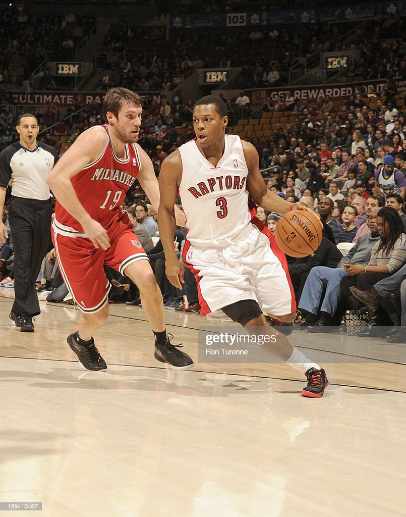 Kyle Lowry #3 of the Toronto Raptors drives the ball up court against Beno Udrih #19 of the Milwaukee Bucks during the game between the Toronto Raptors and the Milwaukee Bucks on January 13, 2013 at the Air Canada Centre in Toronto, Ontario, Canada.