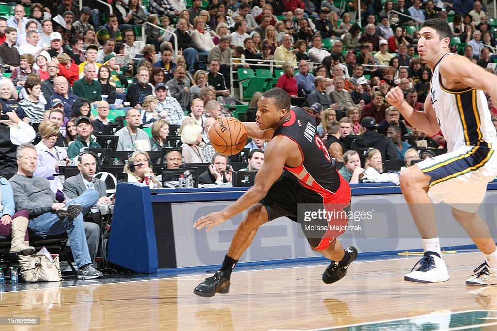 <a gi-track='captionPersonalityLinkClicked' href=/galleries/search?phrase=Kyle+Lowry&family=editorial&specificpeople=714625 ng-click='$event.stopPropagation()'>Kyle Lowry</a> #3 of the Toronto Raptors drives to the basket against <a gi-track='captionPersonalityLinkClicked' href=/galleries/search?phrase=Enes+Kanter&family=editorial&specificpeople=5621416 ng-click='$event.stopPropagation()'>Enes Kanter</a> #0 of the Utah Jazz at Energy Solutions Arena on December 07, 2012 in Salt Lake City, Utah.
