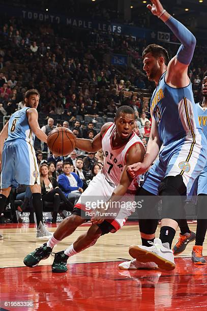 Kyle Lowry of the Toronto Raptors drives to the basket against Jusuf Nurkic of the Denver Nuggets during a game on October 31 2016 at the Air Canada...