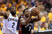 Kyle Lowry of the Toronto Raptors drives to the basket against Kyrie Irving of the Cleveland Cavaliers in the third quarter in game five of the...