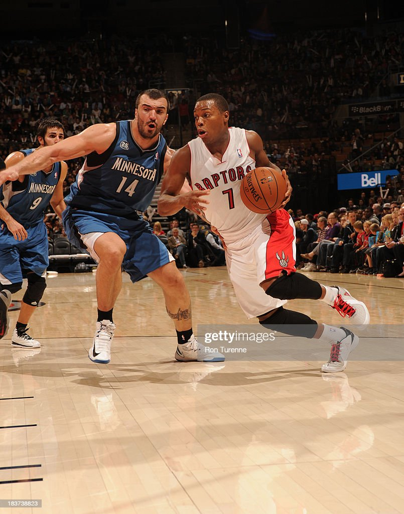 Kyle Lowry #7 of the Toronto Raptors drives to the basket against Nikola Pekovic #14 of the Minnesota Timberwolves during the game on October 9, 2013 at the Air Canada Centre in Toronto, Ontario, Canada.