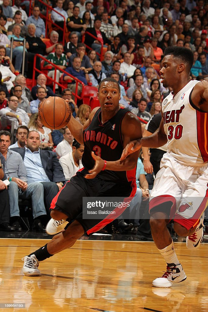 <a gi-track='captionPersonalityLinkClicked' href=/galleries/search?phrase=Kyle+Lowry&family=editorial&specificpeople=714625 ng-click='$event.stopPropagation()'>Kyle Lowry</a> #3 of the Toronto Raptors drives to the basket against <a gi-track='captionPersonalityLinkClicked' href=/galleries/search?phrase=Norris+Cole&family=editorial&specificpeople=5770147 ng-click='$event.stopPropagation()'>Norris Cole</a> #30 of the Miami Heat on January 23, 2013 at American Airlines Arena in Miami, Florida.