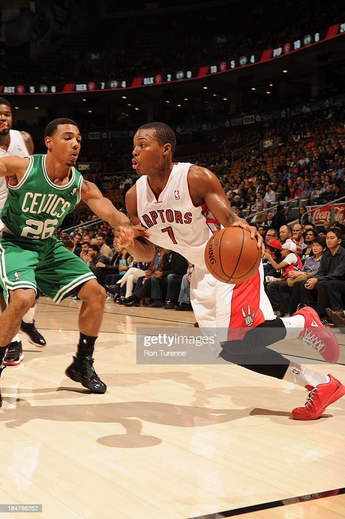 Kyle Lowry #7 of the Toronto Raptors drives to the basket against Phil Pressey #26 of the Boston Celtics during the game on October 16, 2013 at the Air Canada Centre in Toronto, Ontario, Canada.