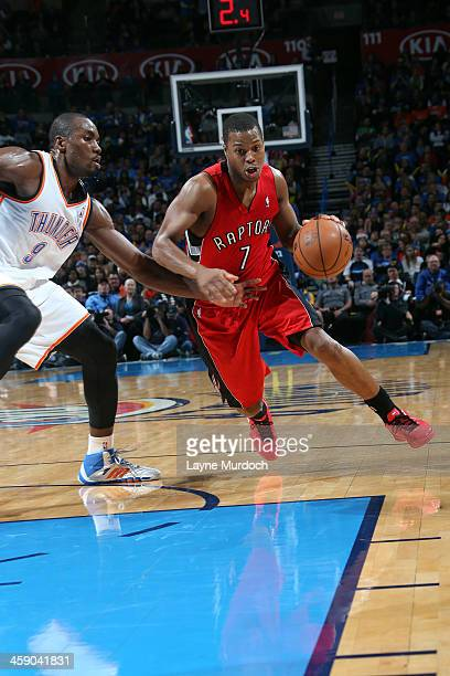 Kyle Lowry of the Toronto Raptors drives to the basket against Serge Ibaka of the Oklahoma City Thunder on December 22 2013 at the Chesapeake Energy...