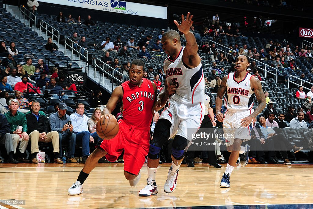 <a gi-track='captionPersonalityLinkClicked' href=/galleries/search?phrase=Kyle+Lowry&family=editorial&specificpeople=714625 ng-click='$event.stopPropagation()'>Kyle Lowry</a> #3 of the Toronto Raptors drives to the basket against the Atlanta Hawks on January 30, 2013 at Philips Arena in Atlanta, Georgia.