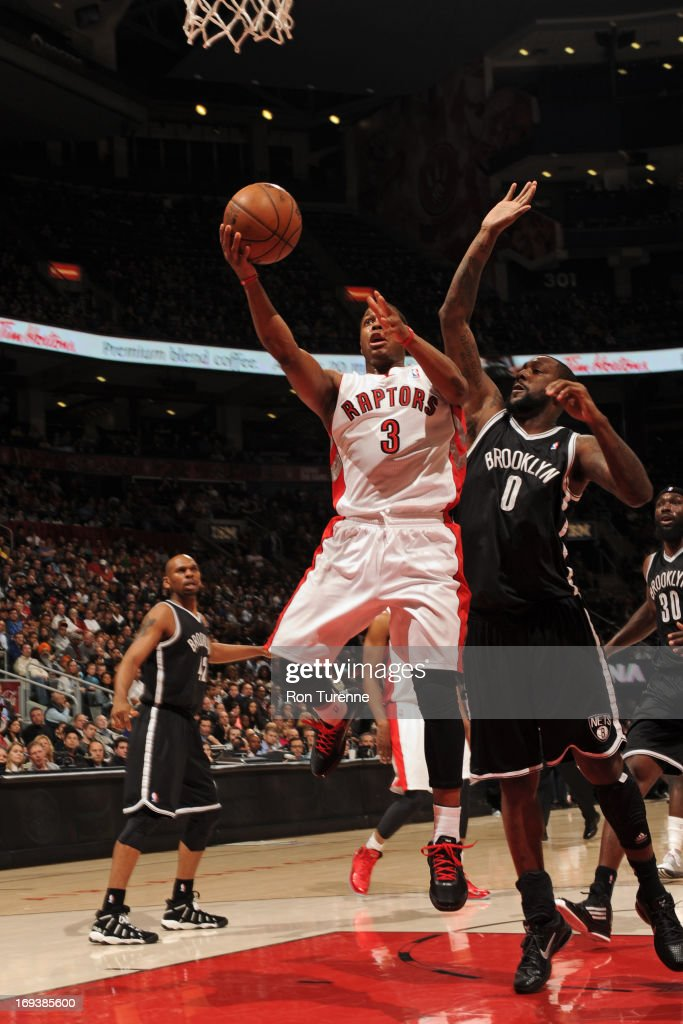 Kyle Lowry #3 of the Toronto Raptors drives to the basket against the Brooklyn Nets during the game on April 14, 2013 at the Air Canada Centre in Toronto, Ontario, Canada.