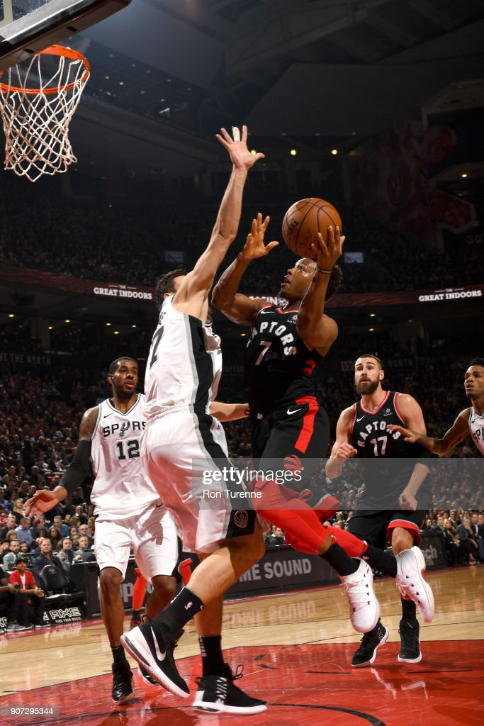 Kyle Lowry #7 of the Toronto Raptors drives to the basket against the San Antonio Spurs on December 5, 2017 at the Air Canada Centre in Toronto, Ontario, Canada.