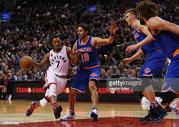 Kyle Lowry of the Toronto Raptors drives to the basket as Sasha Vujacic of the New York Knicks defends during an NBA game at the Air Canada Centre on...