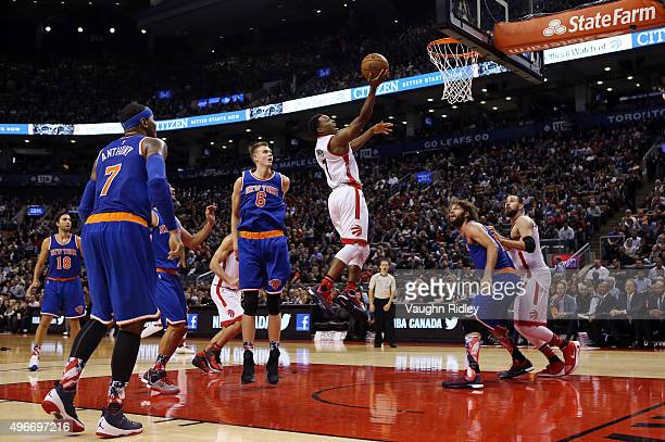 Kyle Lowry of the Toronto Raptors drives to the basket during an NBA game against the New York Knicks at the Air Canada Centre on November 10 2015 in...