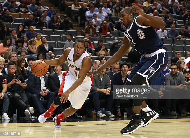 Kyle Lowry of the Toronto Raptors drives to the basket past Serge Ibaka of the Oklahoma City Thunder during their game at Air Canada Centre on...