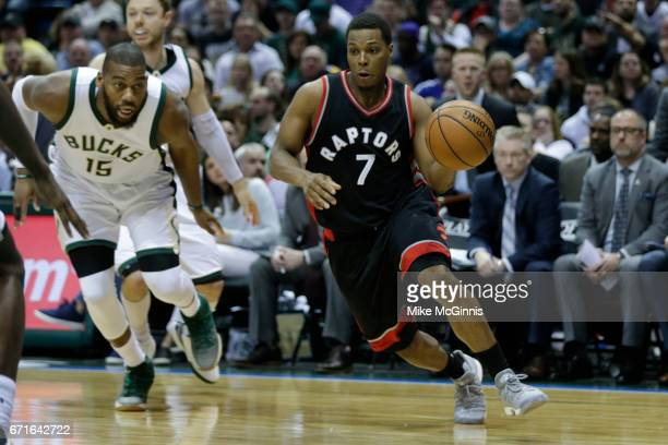 Kyle Lowry of the Toronto Raptors drives to the hoop against the Milwaukee Bucks during the second half of Game Four of the Eastern Conference...