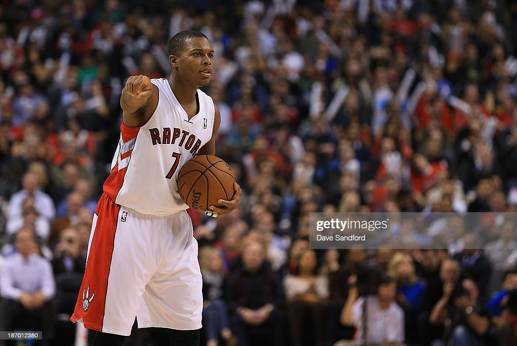 Kyle Lowry #7 of the Toronto Raptors gives direction to his teammates as they face the Boston Celtics during their NBA game at the Air Canada Centre on October 30, 2013 in Toronto, Ontario, Canada.