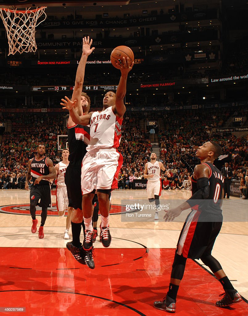<a gi-track='captionPersonalityLinkClicked' href=/galleries/search?phrase=Kyle+Lowry&family=editorial&specificpeople=714625 ng-click='$event.stopPropagation()'>Kyle Lowry</a> #7 of the Toronto Raptors glides to the basket against the Portland Trail Blazers during the game on November 17, 2013 at the Air Canada Centre in Toronto, Ontario, Canada.
