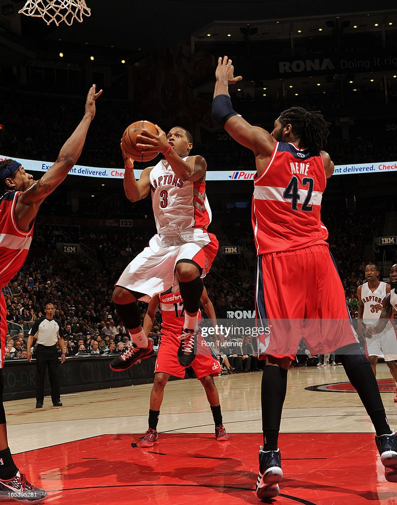 Kyle Lowry #3 of the Toronto Raptors glides to the hoop for the score against the Washington Wizards during the game on April 3, 2013 at the Air Canada Centre in Toronto, Ontario, Canada.