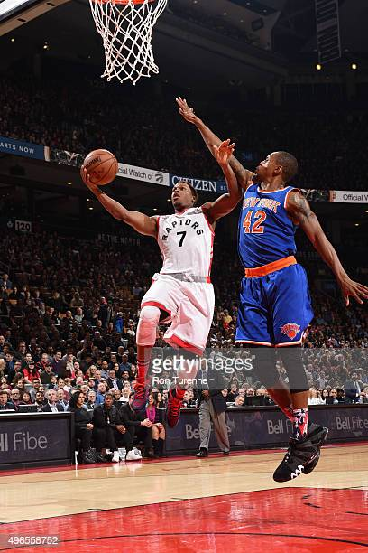 Kyle Lowry of the Toronto Raptors goes for the layup against Lance Thomas of the New York Knicks during the game on November 10 2015 at Air Canada...