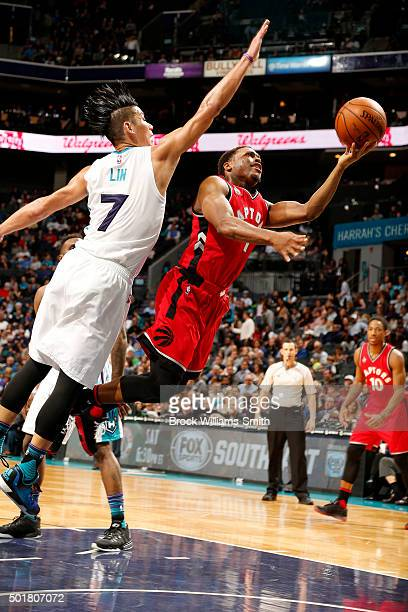 Kyle Lowry of the Toronto Raptors goes for the layup during the game against Jeremy Lin of the Charlotte Hornets on December 17 2015 at Time Warner...