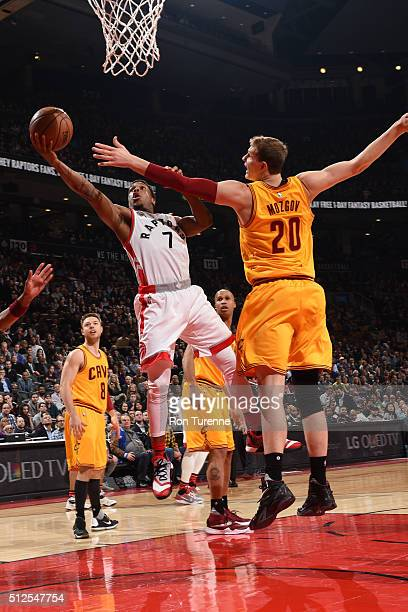 Kyle Lowry of the Toronto Raptors goes for the layup Timofey Mozgov of the Cleveland Cavaliers during the game on February 26 2016 at Air Canada...