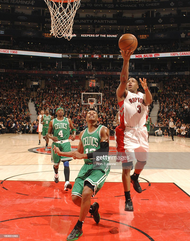 Kyle Lowry #3 of the Toronto Raptors goes to the basket against Leandro Barbosa #12 of the Boston Celtics during the game between the the Toronto Raptors and the Boston Celtics on February 6, 2013 at the Air Canada Centre in Toronto, Ontario, Canada.
