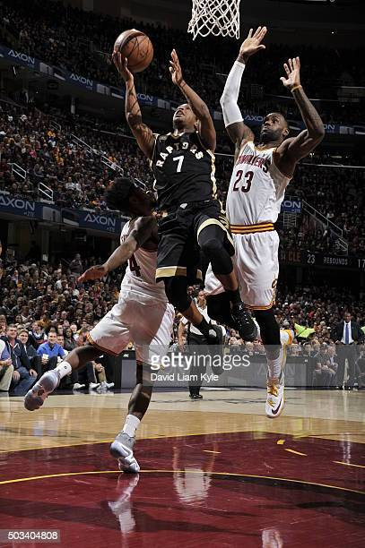 Kyle Lowry of the Toronto Raptors goes to the basket against LeBron James and Iman Shumpert of the Cleveland Cavaliers on January 4 2016 at Quicken...