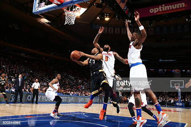 Kyle Lowry of the Toronto Raptors goes to the basket against the New York Knicks on April 10 2016 at Madison Square Garden in New York City NOTE TO...