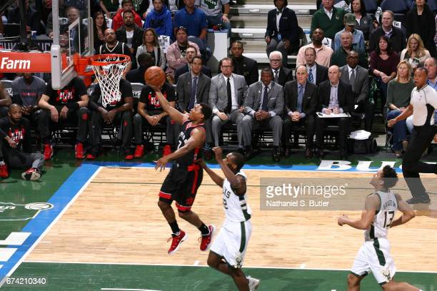 Kyle Lowry of the Toronto Raptors goes up for a lay up against the Milwaukee Bucks during Game Six of the Eastern Conference Quarterfinals of the...