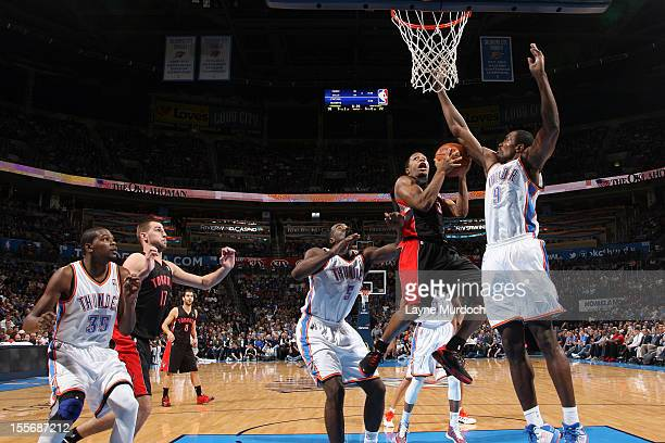 Kyle Lowry of the Toronto Raptors goes up for a shot vs Serge Ibaka of the Oklahoma City Thunder during an NBA game on November 6 2012 at the...
