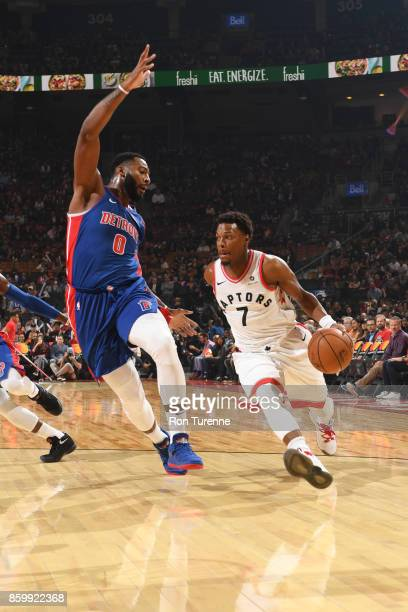 Kyle Lowry of the Toronto Raptors handles the ball against Andre Drummond of the Detroit Pistons during the preseason game on October 10 2017 at the...