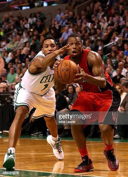 Kyle Lowry of the Toronto Raptors handles the ball against Evan Turner of the Boston Celtics in the second half at TD Garden on November 5 2014 in...