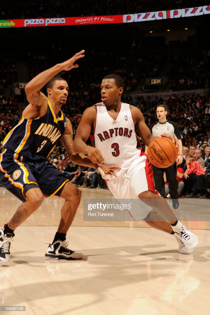 Kyle Lowry #3 of the Toronto Raptors handles the ball against George Hill #3 of the Indiana Pacers on October 31, 2012 at the Air Canada Centre in Toronto, Ontario, Canada.