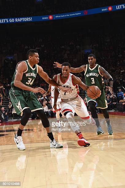 Kyle Lowry of the Toronto Raptors handles the ball against Giannis Antetokounmpo of the Milwaukee Bucks on December 11 2015 at the Air Canada Centre...