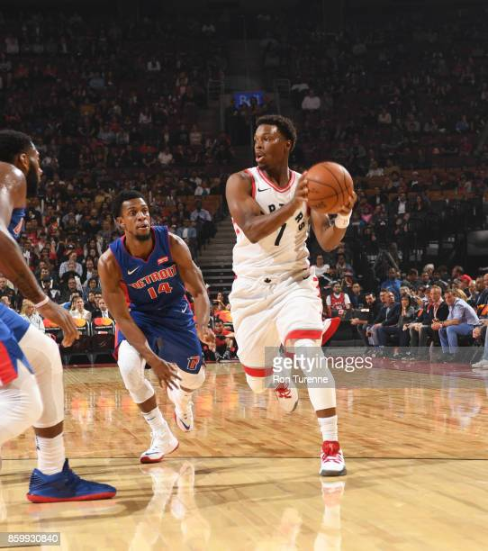 Kyle Lowry of the Toronto Raptors handles the ball against Ish Smith of the Detroit Pistons during the preseason game on October 10 2017 at the Air...