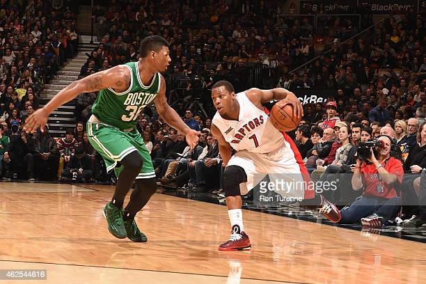 Kyle Lowry of the Toronto Raptors handles the ball against Marcus Smart of the Boston Celtics on January 10 2015 at the Air Canada Centre in Toronto...