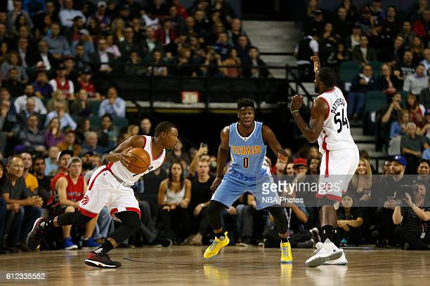 Kyle Lowry of the Toronto Raptors handles the ball against the Denver Nuggets on October 3 2016 at the Scotiabank Saddledome in Calagary Alberta...
