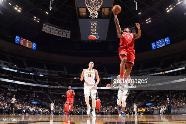 Kyle Lowry of the Toronto Raptors handles the ball against the Denver Nuggets on November 1 2017 at the Pepsi Center in Denver Colorado NOTE TO USER...