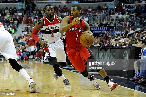 Kyle Lowry of the Toronto Raptors handles the ball in the first quarter against John Wall of the Washington Wizards during Game Four of the Eastern...