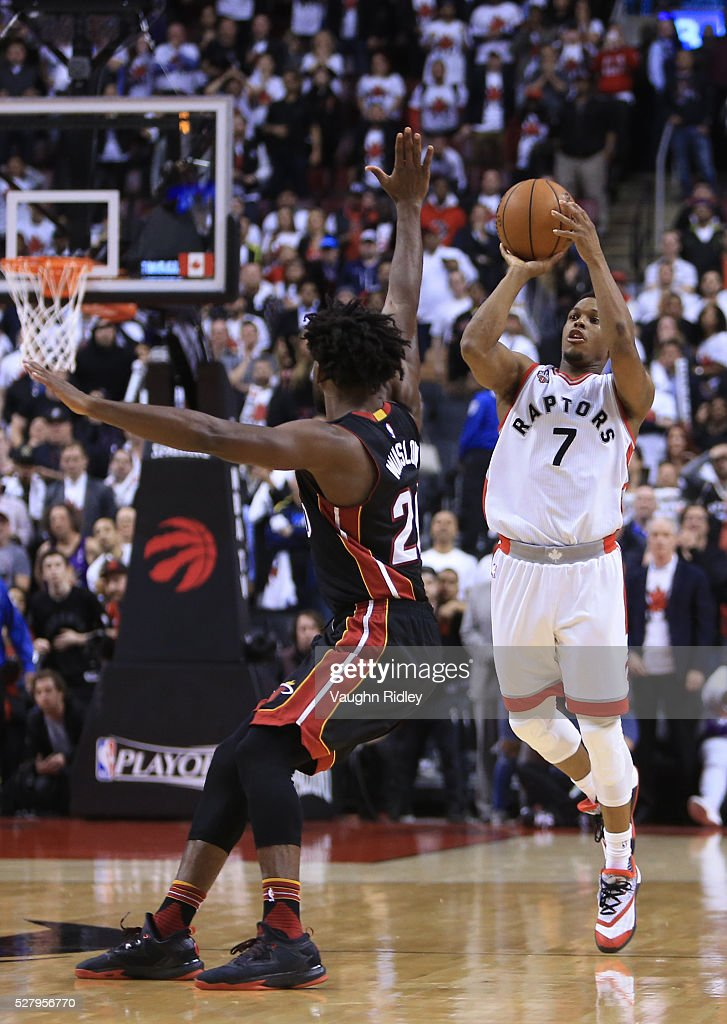 <a gi-track='captionPersonalityLinkClicked' href=/galleries/search?phrase=Kyle+Lowry&family=editorial&specificpeople=714625 ng-click='$event.stopPropagation()'>Kyle Lowry</a> #7 of the Toronto Raptors hits a half-court buzzer beater to tie Game One and send it into overtime during the Eastern Conference Semifinals against the Miami Heat during the 2016 NBA Playoffs at the Air Canada Centre on May 3, 2016 in Toronto, Ontario, Canada.