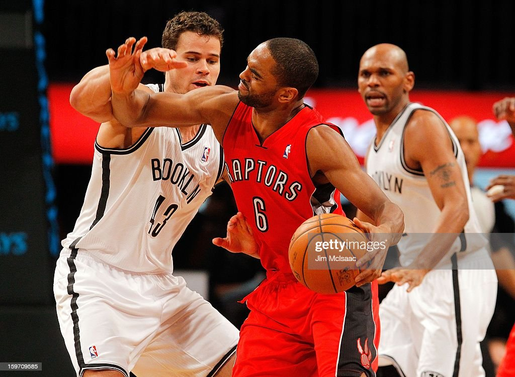 Kyle Lowry #3 of the Toronto Raptors in action against Kris Humphries #43 of the Brooklyn Nets at Barclays Center on January 15, 2013 in the Brooklyn borough of New York City.The Nets defeated the Raptors 113-106.