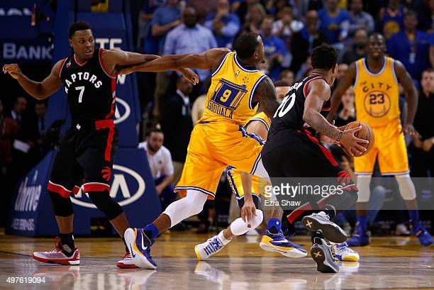 Kyle Lowry of the Toronto Raptors is called for an offensive foul in the final minute of their game against the Golden State Warriors while DeMar...