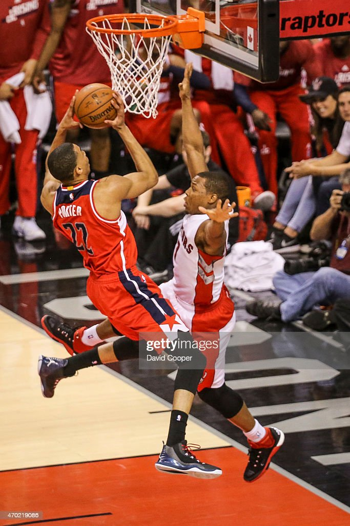 TORONTO, ON- APRIL 18 - Kyle Lowry (7) of the Toronto Raptors is called for the foul on Otto Porter Jr. (22) of the Washington Wizards late in the 2nd quarter of the game between the Toronto Raptors and the Washington Wizards at the Air Canada Centre April 18, 2015