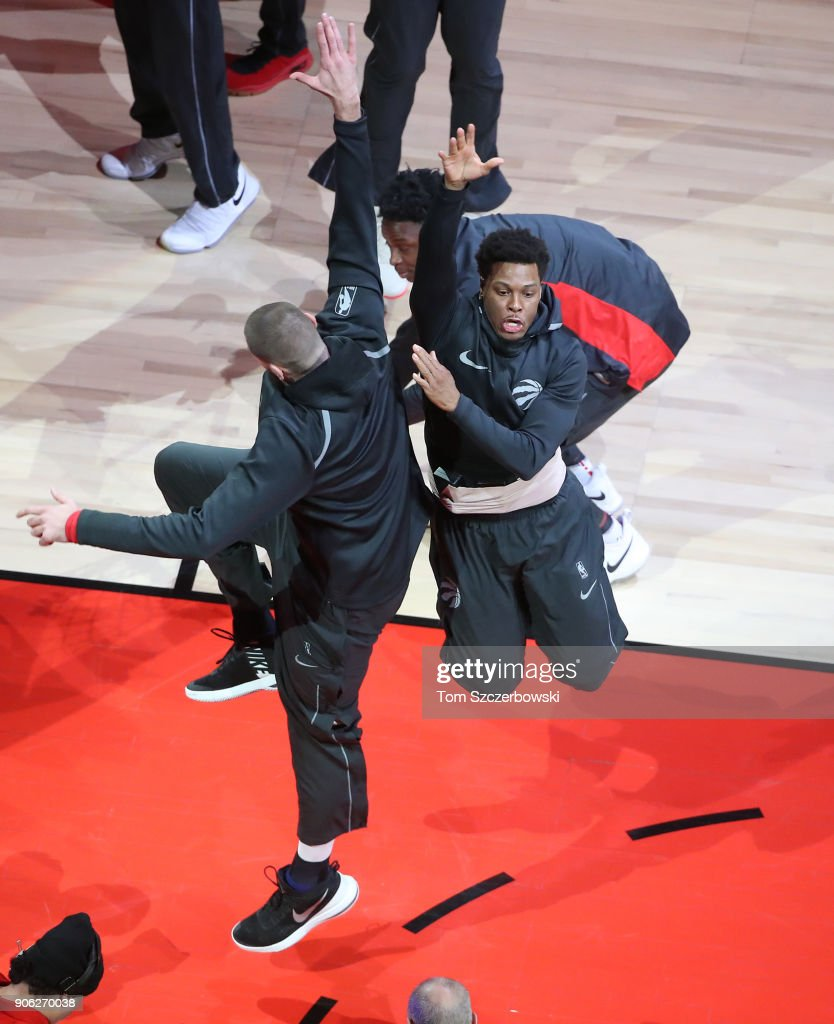 Kyle Lowry #7 of the Toronto Raptors is greeted by Jonas Valanciunas #17 during pre-game introductions prior to the start of a game against the Detroit Pistons at Air Canada Centre on January 17, 2018 in Toronto, Canada.