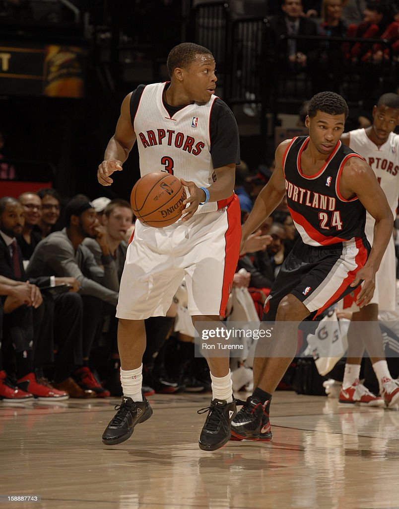 Kyle Lowry #3 of the Toronto Raptors looks for the open man against the Portland Trail Blazers during the game on January 2, 2013 at the Air Canada Centre in Toronto, Ontario, Canada.