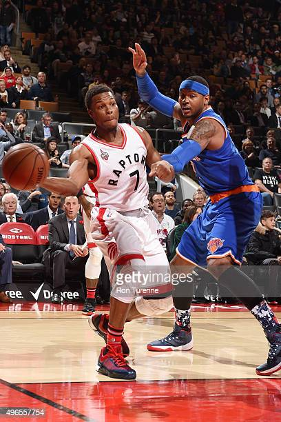 Kyle Lowry of the Toronto Raptors looks to move the ball against Carmelo Anthony of the New York Knicks during the game on November 10 2015 at Air...