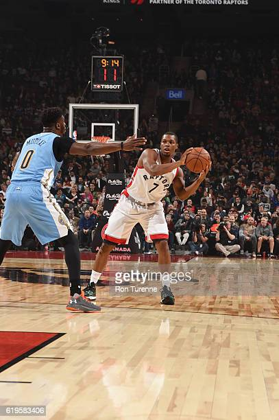 Kyle Lowry of the Toronto Raptors looks to pass the ball against Emmanuel Mudiay of the Denver Nuggets during a game on October 31 2016 at the Air...