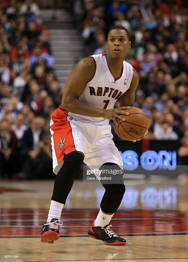 Kyle Lowry #7 of the Toronto Raptors looks to pass the ball against the Boston Celtics during their NBA game at the Air Canada Centre on October 30, 2013 in Toronto, Ontario, Canada.