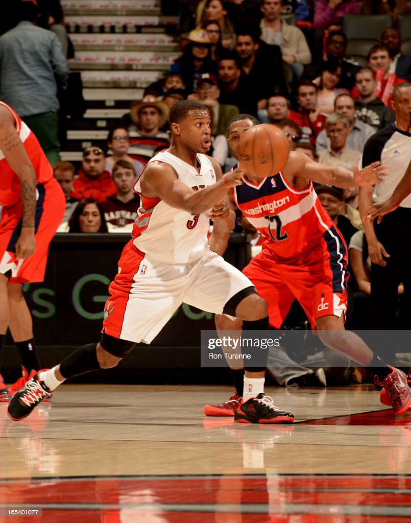 Kyle Lowry #3 of the Toronto Raptors passes the ball against the Washington Wizards during the game on April 3, 2013 at the Air Canada Centre in Toronto, Ontario, Canada.