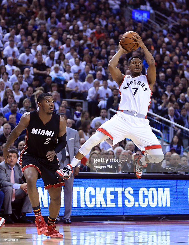 <a gi-track='captionPersonalityLinkClicked' href=/galleries/search?phrase=Kyle+Lowry&family=editorial&specificpeople=714625 ng-click='$event.stopPropagation()'>Kyle Lowry</a> #7 of the Toronto Raptors passes the ball as <a gi-track='captionPersonalityLinkClicked' href=/galleries/search?phrase=Joe+Johnson+-+Basketball+Player&family=editorial&specificpeople=201652 ng-click='$event.stopPropagation()'>Joe Johnson</a> #2 of the Miami Heat defends in the first half of Game Two of the Eastern Conference Semifinals during the 2016 NBA Playoffs at the Air Canada Centre on May 5, 2016 in Toronto, Ontario, Canada.