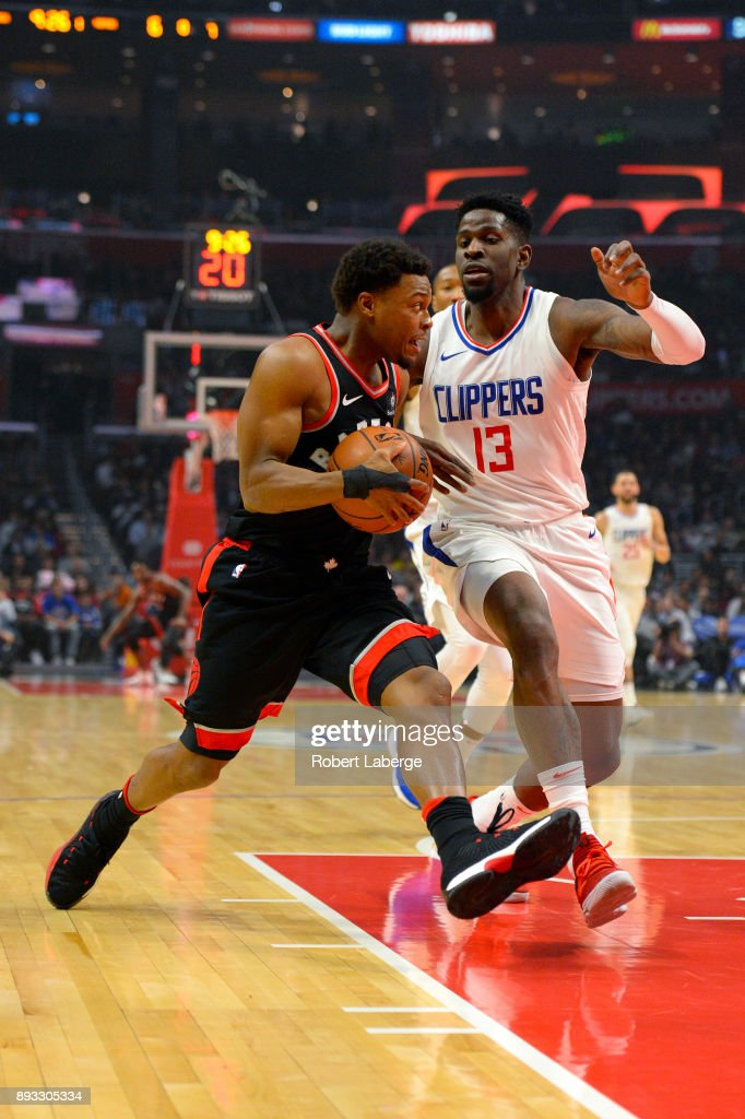 Kyle Lowry #7 of the Toronto Raptors plays against Jamil Wilson #13 of Los Angeles Clippers on December 11, 2017 at STAPLES Center in Los Angeles, California.